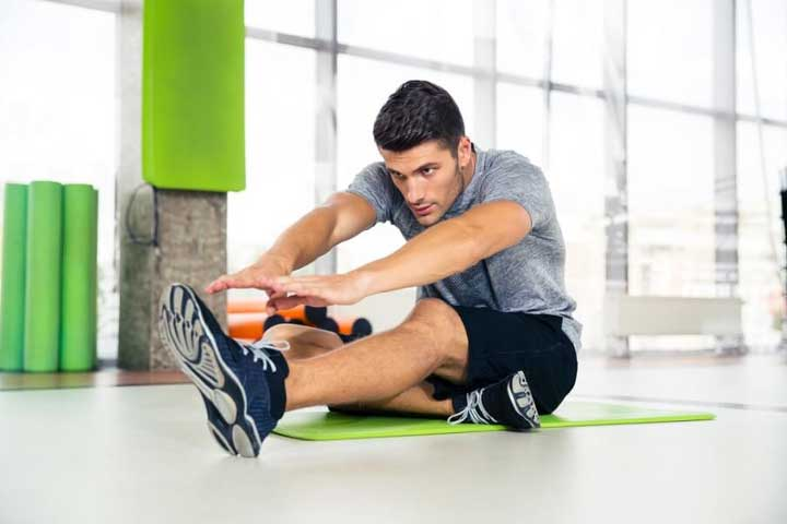 A man stretching at the gym