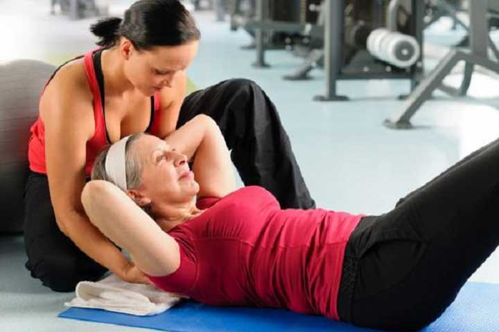 Two women at the gym working out