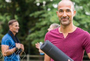 An image of a man with a yoga mat