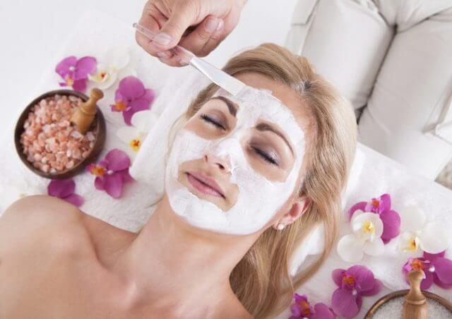 A woman getting a luxurious facial at a spa