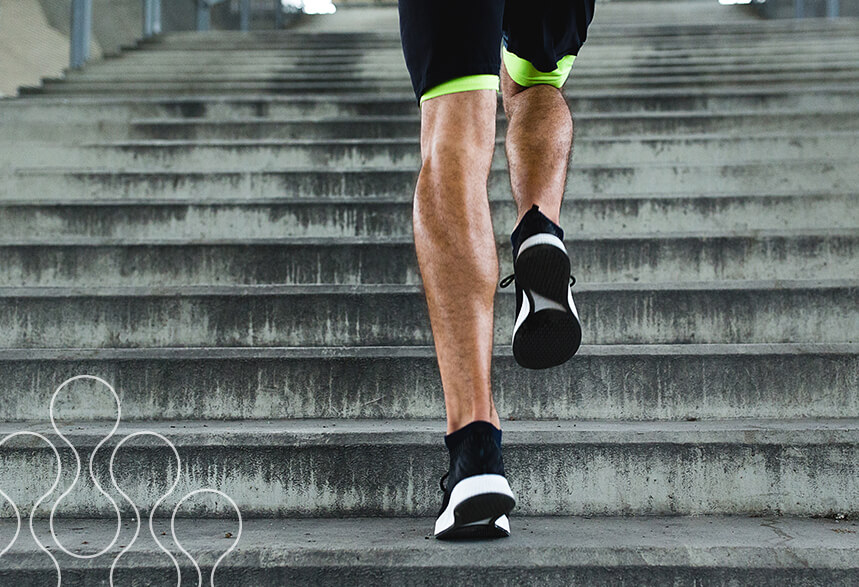 A man running up the stairs outdoors